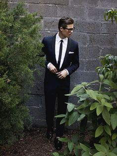 Hair glasses tux. Pocket square and no socks also cool.