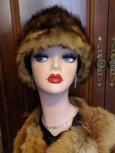 Early Art Deco Depression (1930-1946) Period Genuine Stone Marten Fur Cloche Toque Hat, from the early Deco period or older, made of genuine marten fur deep cloche or tall toque style hat, hand sewn from large strips of stone marten fur, lined w/ hand stitched burgundy satin w/ a brown grosgrain ribbon band. very soft and plush with long guard hairs that are a dark glossy brown fading to a golden brown with a very dense creamy blond undercoat.