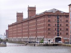 Grade II listed warehouse conversion apartments on Waterloo Road, Liverpool Docklands. Exposed brick walls, vaulted ceilings, with original heritage features. Liverpool Life, Liverpool Docks, Liverpool History, Riverside Apartment, Warehouse Apartment, Car Part Furniture, Automotive Furniture, Automotive Decor, Anglican Cathedral
