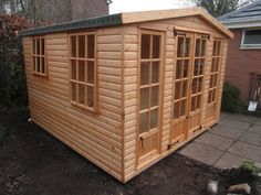 10ft x 12ft wooden summerhouse with added extras including opening windows and static door panels