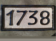 """FOUR NUMBER CUSTOM CERAMIC HOUSE NUMBER PLAQUE Enhance your curb appeal with a unique and charming hand crafted feature! You can order from this listing if you need FOUR NUMBERs on your plaque. If you need something else, search """"three number"""", etc. in my shop. The shape of the plaque can be OVAL or RECTANGULAR, just let me know when ordering here. THIS SAMPLE: The glazes used in this 1738 sample are Moonlit  on numbers and border, and clear satin on the textured/hammered background ( te..."""