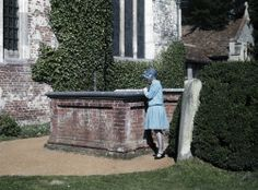1920s English women in color. At the tomb of Thomas Gray near a church in Stoke Poges, Buckinghamshire