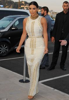 Navy inspired: Kim wore a Balmain dress fashioned out of rope with golden details as she embarked on MailOnline's yacht