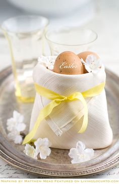 Similar to the holiday crown, this pouch-like napkin fold lets you fill it up with whatever you'd like. In this example, Easter eggs were added. Other options are name tags, flowers, or breadsticks.