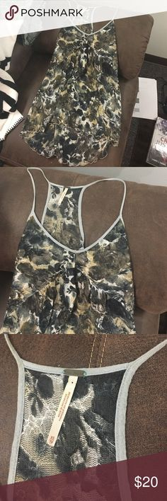 Free People Blouse Good condition, size XS but will fit a small, looks gorgeous. Free People Tops Blouses