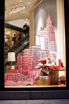 the city, pinned by Ton van der Veer #windowdisplay #judithm This display would be more dramatic if one could not see the inside of the store and people going up the stairs/escalator.