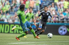 Obafemi Martins flips the ball past San Jose goalkeeper Jon Busch for the fourth goal of the game. Photo by Dean Rutz / The Seattle Times