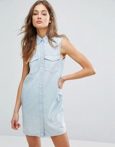 Buy Levi's Sleeveless Western Dress at ASOS. With free delivery and return options (Ts&Cs apply), online shopping has never been so easy. Get the latest trends with ASOS now. Robes Western, Western Dresses, Tall Dresses, Blue Dresses, Dresses With Sleeves, Jean Shirt Dress, Jeans Dress, Sleeveless Denim Dress, Maxi Robes
