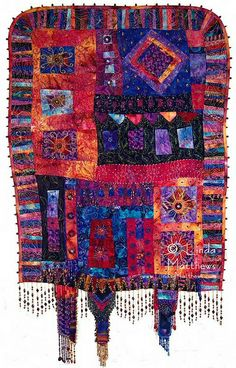 """""""Soliloquy"""". Art quilt, heavily free motion machine quilted and hand beaded."""