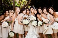 Each bridesmaid has a bouquet of one type of flower..then the bride has a bouquet with each kind