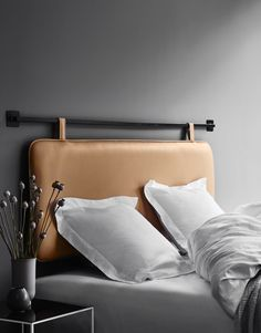 This high quality creamy leather headboard is made in the finest aniline leather & wall mounted with your preferred rings or hooks.