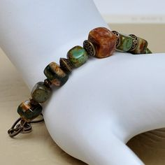 bebsbeads - etsy.  These could be done in Polymer Clay....pretty