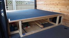 Platform for bed and storage underneath. Could also make folding/removable bed slats, to allow mattress to breathe.