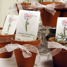 Terra cotta pots are adorable with Personalized Seed Favors... I think something plantable is a great wedding favor.