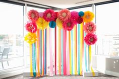 This bright backdrop creates a fun option for photos. | Fiesta Themed Oklahoma Wedding Captured by Ely Fair Photography | Kelsey + Kyle #bridesofok #oklahomabride #decor #backdrop