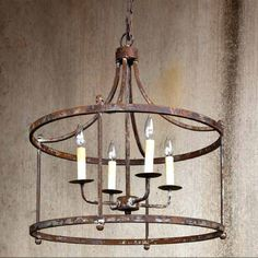 Our story is that it was rescued from the old family home before Sherman took a liking to it. Airy four bulb dual halo fixture in rustic iron that includes a five inch diameter matching canopy and for...