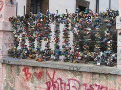 Love locks along the canal near the Charles Bridge in Prague's Mala Strana.