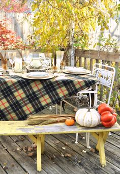 plaid blanket as a tablecloth adds to the fall decor