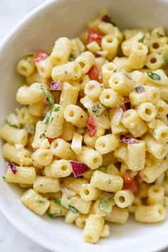 This old-fashioned macaroni salad with crisp vegetables dressed in a creamy but light mayonnaise dressing is just right for any picnic or barbecue.