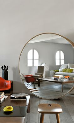 large circle mirror behind couch