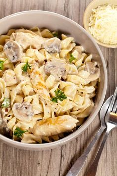 One Pot Chicken and Mushroom Pasta in a white bowl with basil.
