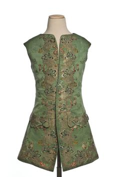 Waistcoat, France, 1740-1750. Green silk, richly embroidered with large stylised flowers an leaves in coloured silk and metal threads of several textures.