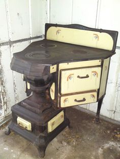 French art deco cooking range in yellow enamel and cast iron