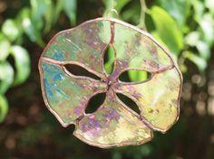 Iridescent stained glass sand dollar suncatcher by ArdsleyArtGlass, $15.00
