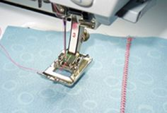 "Improved French Seam.  Use Bernina foot #23 or #3.  ZIGZAG the 1/8"" seam w wrong sides together, press to one side and fold fabric right sides together, fit the little zigzag into the groove of the foot, move the needle over 2 spaces and straight stitch for the neatest, no fray French seam you've never cussed over!"