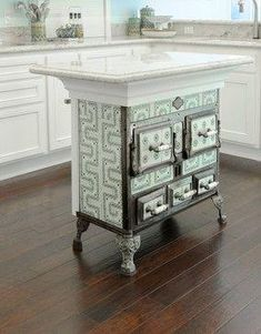 18th Century stove, repurposed into a kitchen island!! LOVE!!