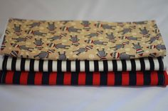 Set of three burp cloths, one sock monkey, one black/cream striped and one red/navy striped #sockmonkey #sock #monkey $15