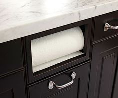 Kitchens that maximize small footprints: Built-in paper towel roll holder - a must-have for my future kitchen remodel!: http://www.bhg.com/kitchen/small/maximized-kitchen-footprint/