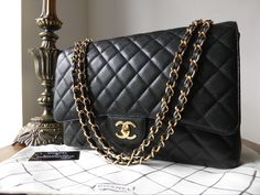 This is a authentic Chanel Timeless Classic Maxi flap bag in Black Caviar leather with shiny gold tone hardware. Current RRP (April Condition - Excellent* Details The leather is superb. Puffy, clean, robust and with one one ex Channel Bags, Chanel News, Coco Chanel, Chanel Classic Flap, New Bag, Handbags Online, Chanel Handbags, Timeless Classic, Lambskin Leather