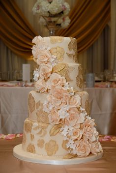 Ornate brushed embroidery hand painted with gold luster and adorned with beautiful full bloom sugar roses and hydrangeas