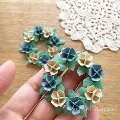Learn more about Origami Paper Folding Origami Wreath, Paper Origami Flowers, Origami Paper Folding, Origami Star Box, Origami And Kirigami, Origami Fish, Paper Crafts Origami, Diy Origami, Origami Tutorial