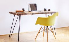 This wood table is handmade from reclaimed wood featuring a distinct grain pattern and has a live edge top and hairpin steel legs. This modern-with-a-rustic-twist natural design is simply stunning. Perfect for your home office.