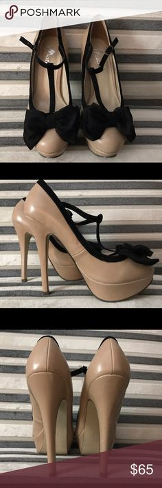 NEW Nude Pumps with Black bow Super cute nude heels with Black bow on toe. Never been worn. Heel is about 5 inches. No trades 😬 Please make all offers via offer button! Shoes Heels