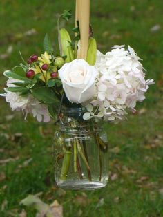 Could be cute for the ceremony with yellow and white flowers in a mason jar!