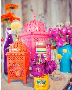 colorful summer décor...lanterns with tea lights and recycled cans with wildflowers