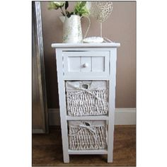 white coffee table with wicker baskets