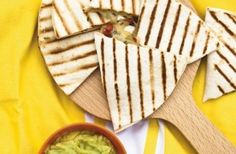 Cheese and tomato tortillas These crispy grilled tortillas are sandwiched with a tasty, mouth-watering filling of cheese, tomato and coriander. An easy snack to cook on a BBQ grill or griddle.
