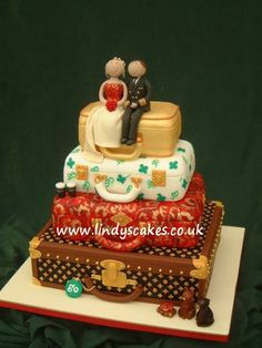 Four tier stacked suitcase wedding cake created by Lindy Smith