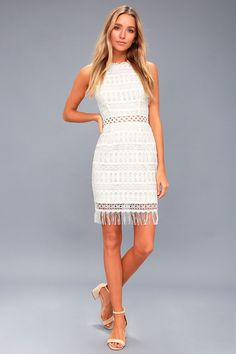 The Kenna White Crochet Lace Sleeveless Bodycon Dress makes any day special! Lovely, white crochet lace overlays a cream, knit lining as it shapes a rounded neckline and darted, sleeveless bodice. Sheer, fitted waist tops a bodycon skirt with an adorable sheer fringe hem. Hidden back zipper/clasp. $66