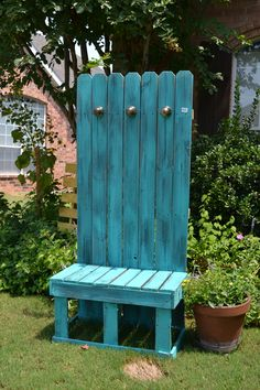 Love the color! Old fence boards to create a cute bench.  Old door knobs serve as hooks.