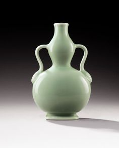A CELADON-GLAZED DOUBLE-GOURD VASE, CHINA, QING DYNASTY, DAOGUANG MARK AND PERIOD (1821-1850)