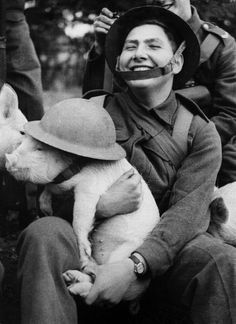 Young Soldier Holding A Little Piggy With Lid In London During World War I (Photo by Keystone-France/Gamma-Keystone via Getty Images)