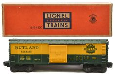 Lionel postwar 6464-300 Rutland, scarce version with solid shield, type IIa rubber-stamped boxcar in OB.  The car has a yellow body with glossy green details.  The car has never been run, C9-10.  The OB has tape repaired flaps.