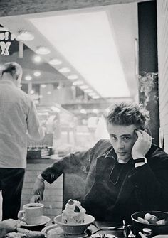 Portrait of James Dean in diner by Dennis Stock, New York, 1954