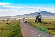 Inner Mongolia highway Car advertisement, highway road, outdoor advertising, natural background, blue sky and white clouds, flowers, autumn, summer, sun, sunrise, China, Inner Mongolia, Xilin Gol, wide road, travel, unmanned, car, fence, green grassland.