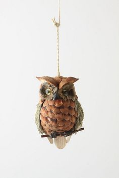 """Bottlebrush Owl Ornament  style # 22681415  Our pinecone creature watches for Santa with all-knowing eyes.   Styrofoam, bottlebrush, pinecone, wood, glitter, plastic   5""""H   Imported     $16"""